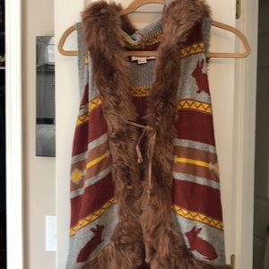 Hooded vest with furry detail
